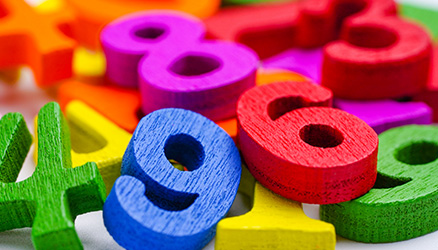 A pile of wooden number blocks for learning to count.
