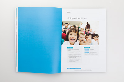 Photograph of a page spread showing a blue colour applied to design elements.