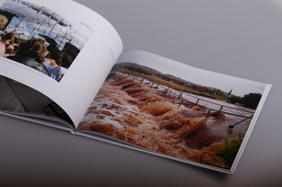 Full-page image with bleed. Image is of flash flooding, June 1989. Partial image, Jimmy Barnes concert, Millars Well Oval, 1988.