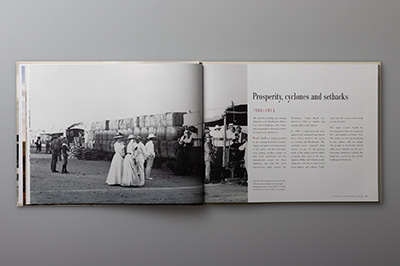 Double-page spread showing steam train in Roebourne, 1910.