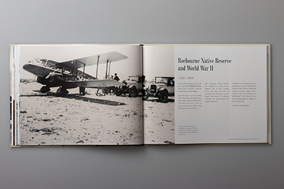 Double-page spread showing a mail service plane on Roebourne airstrip, 1934.