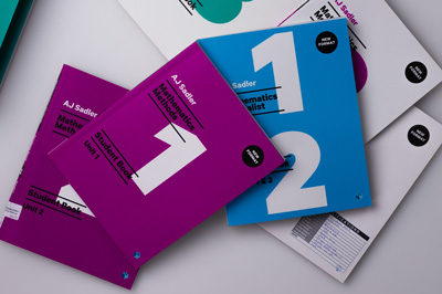 Photograph showing a selection of covers from the Sadler maths series.