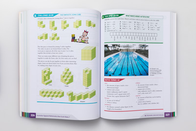 Photograph of a student book page spread showing examples of geometric mathematics illustration drawn for the series.